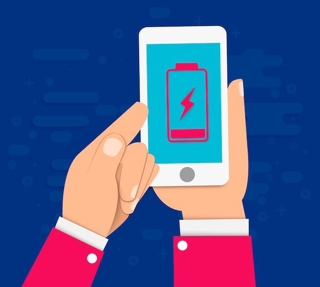 Hand hält ein smartphone mit einer schwachen batterie auf dem bildschirm