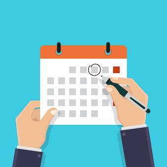 Hand hält einen kalender