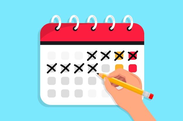 Hand hält einen stift und zeichnet einen kreis auf den kalender