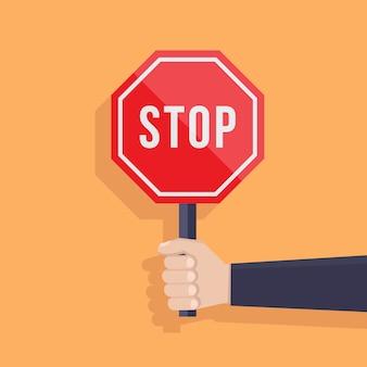 Hand hält flache designillustration des stoppschildes