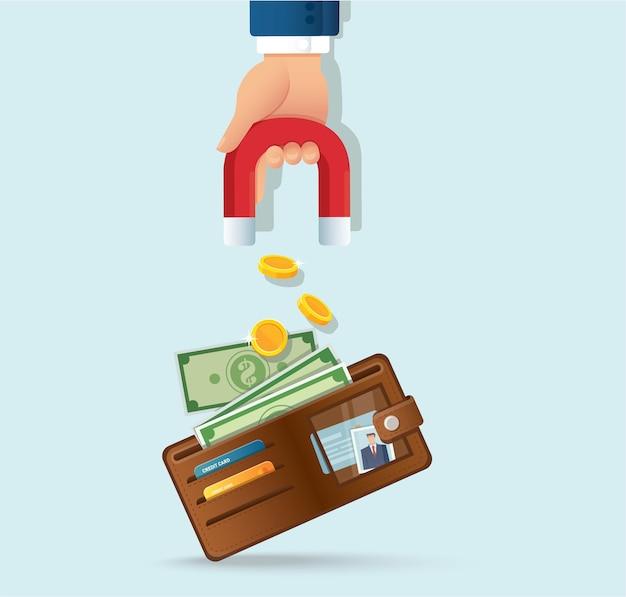 Hand hält magnet, der geld von einer brieftasche anzieht