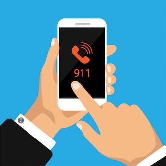 Hand hält smartphone mit 911 nummer auf einem bildschirm.