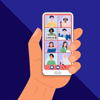 Hand hält smartphone mit videokonferenzen mit freunden.