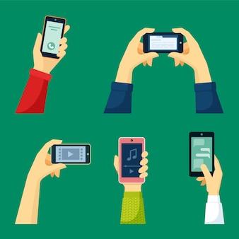Hand hält smartphone-set
