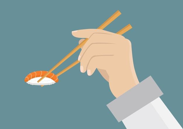 Hand hält sushi