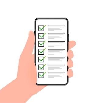 Hand hält telefon mit checkliste auf dem bildschirm auf grünem hintergrund