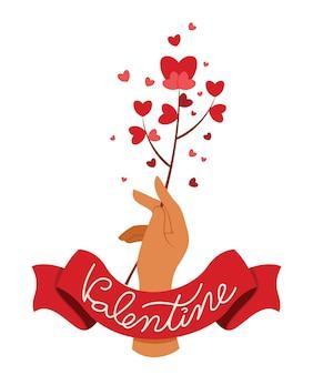 Hand halten eine rote herzblume mit einem band des wortes ist valentinstag.