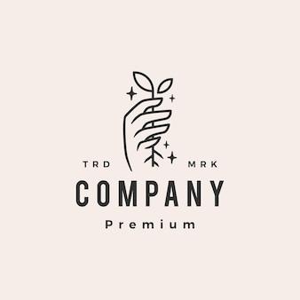 Hand halten pflanzensprossen blatt wachstum hipster vintage logo