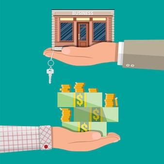 Hand holding shop oder gewerbeimmobilie mit schlüssel.