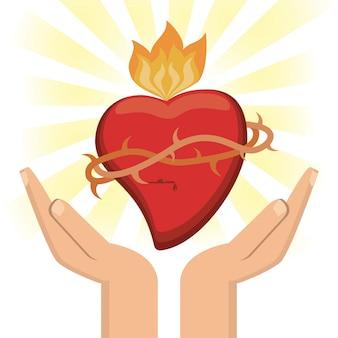 Hand mit bild des heiligen herzens jesus christus Premium Vektoren