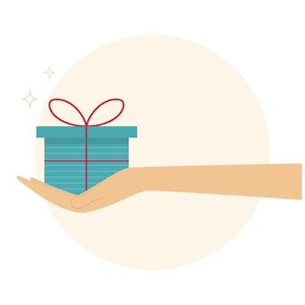 Hand mit einem geschenk