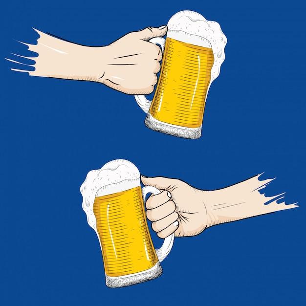 Hand mit einem glas bier