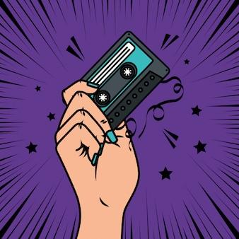 Hand mit kassettenmusik-pop-art-stil