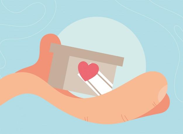 Hand mit kastensymbol der wohltätigkeitsspende