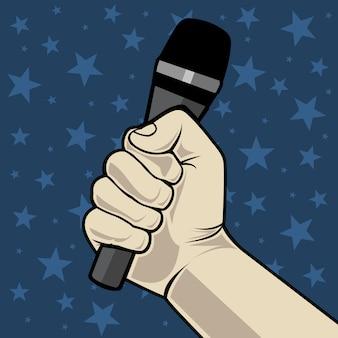 Hand mit mikrofon. auf blauem hintergrund mit sternen.