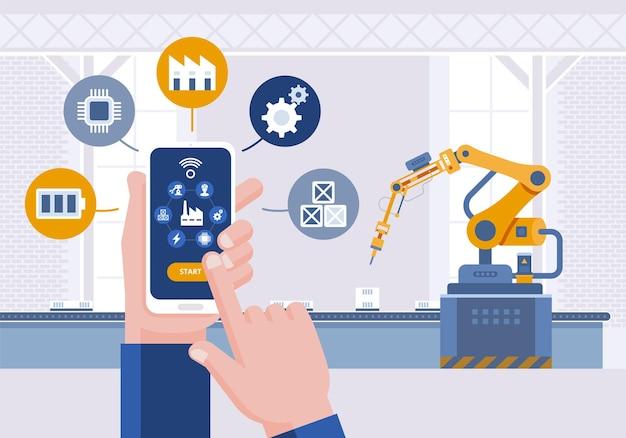Hand mit smartphone. überwachungs-app auf einem smartphone und einer intelligenten automatisierten produktionslinie.