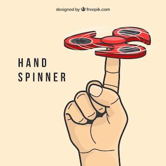Hand spielt mit einem roten spinner