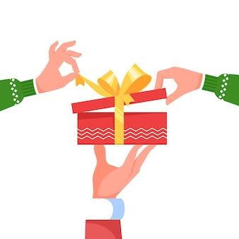 Hand weihnachtsmann halten geben große geschenkbox geschenk. hände kleidung öffnen geschenkbox überraschung. Premium Vektoren