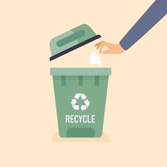 Hand wirft gebrauchtes papier in den müll. recycling-konzept.