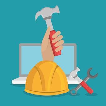 Handarbeiter im bau mit laptop