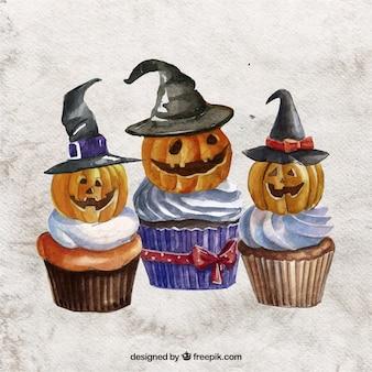 Handbemalte halloween-kleine kuchen mit kürbissen