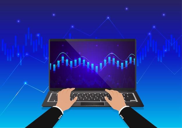 Handeingabe auf der tastatur mit einer trading-grafikmonitor-laptop-ansicht