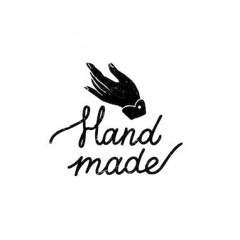 Handgemachtes symbol oder logo. weinlese-stempelikone mit handgemachter beschriftung und hand