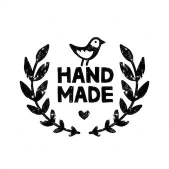 Handgemachtes symbol oder logo. weinlesestempelikone mit handgemachter beschriftung mit lorbeerkranz und niedlichem vogel.
