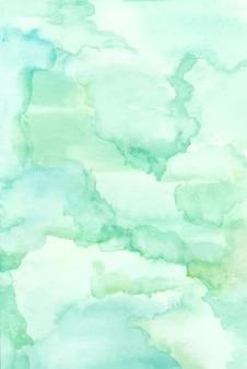 Handgemalt aus hellgrüner und blauer mischung abstrakter aquarellhintergrund