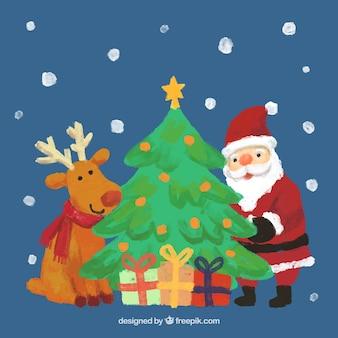 Handgemalte rentier, weihnachtsmann und ein weihnachtsbaum