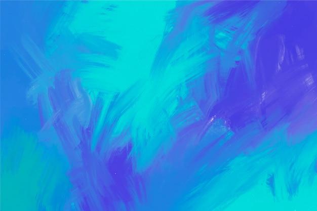 Handgemalter hintergrund in den purpurroten und blauen farben