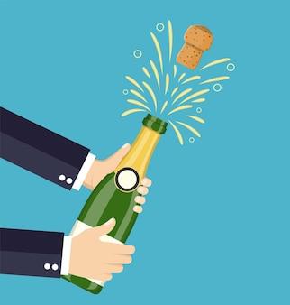 Handgeöffneter champagner, champagnerspritzer