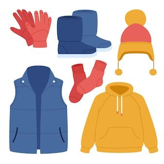 Handgezeichnete flache winterkleidung und essentials-kollektion