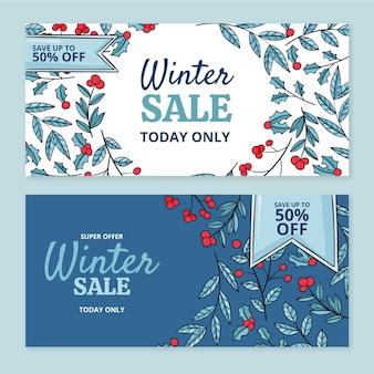 Handgezeichnete horizontale winterschlussverkaufsfahnen eingestellt