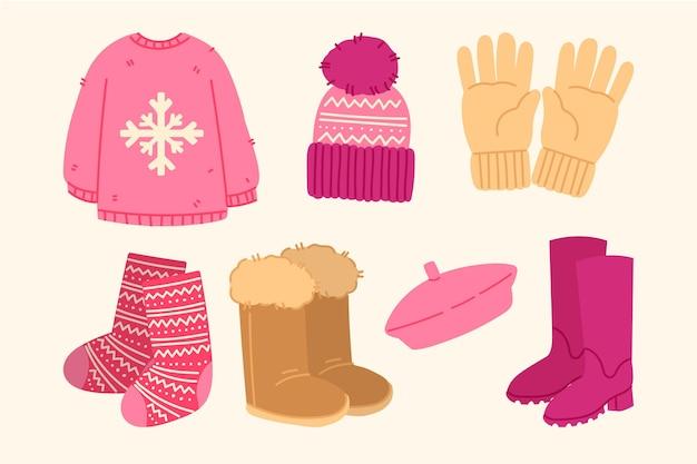 Handgezeichnete winterkleidung und das nötigste Kostenlosen Vektoren