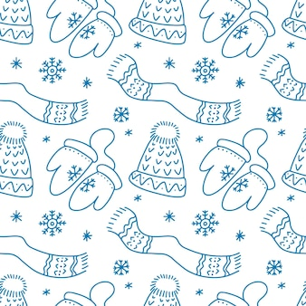 Handgezeichnetes nahtloses muster mit frohe weihnachten-hut-schal-schneeflocken-fäustlingen im doodle-stil