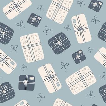 Handgezeichnetes nahtloses muster mit stilvollen geschenkboxen und schleifen auf blauem hintergrund
