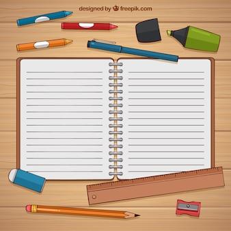 Handgezeichnetes notizbuch mit bleistiften und material