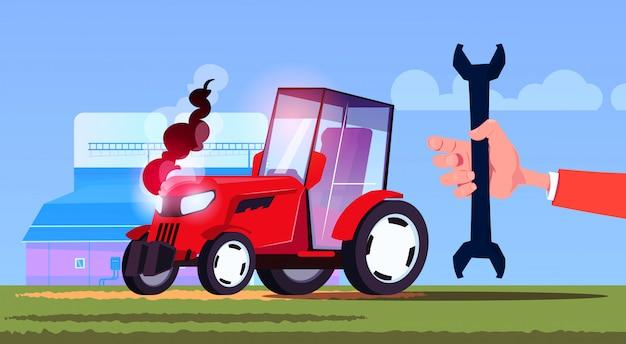 Handgriffschlüssel-traktor, der feld eco landwirtschaftskonzept pflügt