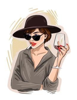 Handzeichnung schönes junges frauenporträt. mode mädchen mit einem glas wein. stilvolle frau in der sonnenbrille. skizzieren.