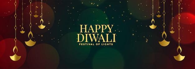 Happy diwali banner mit hängenden diyas