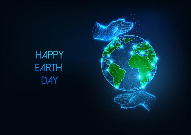 Happy earth day web-banner mit futuristisch leuchtenden niedrigen polygonalen planeten globus und fürsorglichen menschlichen händen