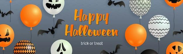 Happy halloween-schriftzug mit fledermäusen und geisterballons