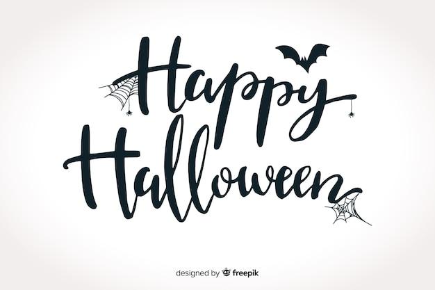 Happy halloween schriftzug mit fledermaus