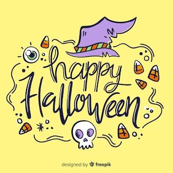 Happy halloween schriftzug mit hexenhut