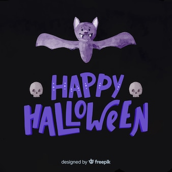 Happy halloween schriftzug mit lila fledermaus