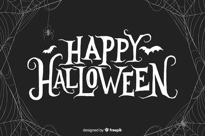Happy halloween schriftzug mit spinnennetz