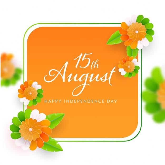 Happy independence day schriftart auf safran und weißem hintergrund mit papierblumen verziert.