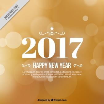 Happy new year, schwarzen buchstaben auf einem goldenen hintergrund