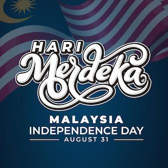 Hari merdeka schriftzug mit flagge blauem hintergrund
